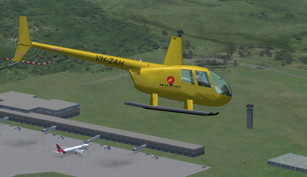 My R44 paint job -over Cairns airport